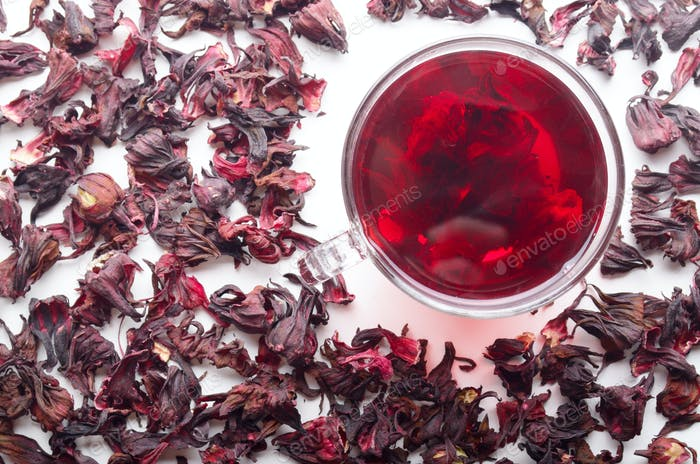 Top view of Hibiscus Tea cup with petals aside on white backgrou