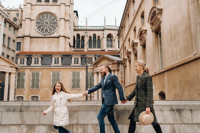 A beautiful family with strolls through the old city of Lyon in France.Family trip to the old cities