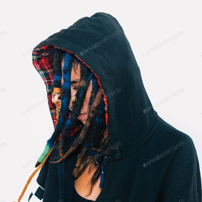 Model in a sweatshirt with dreadlocks and piercings. Fashion acc