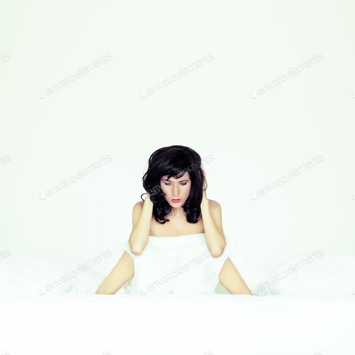 portrait of a sensual girl in white bed