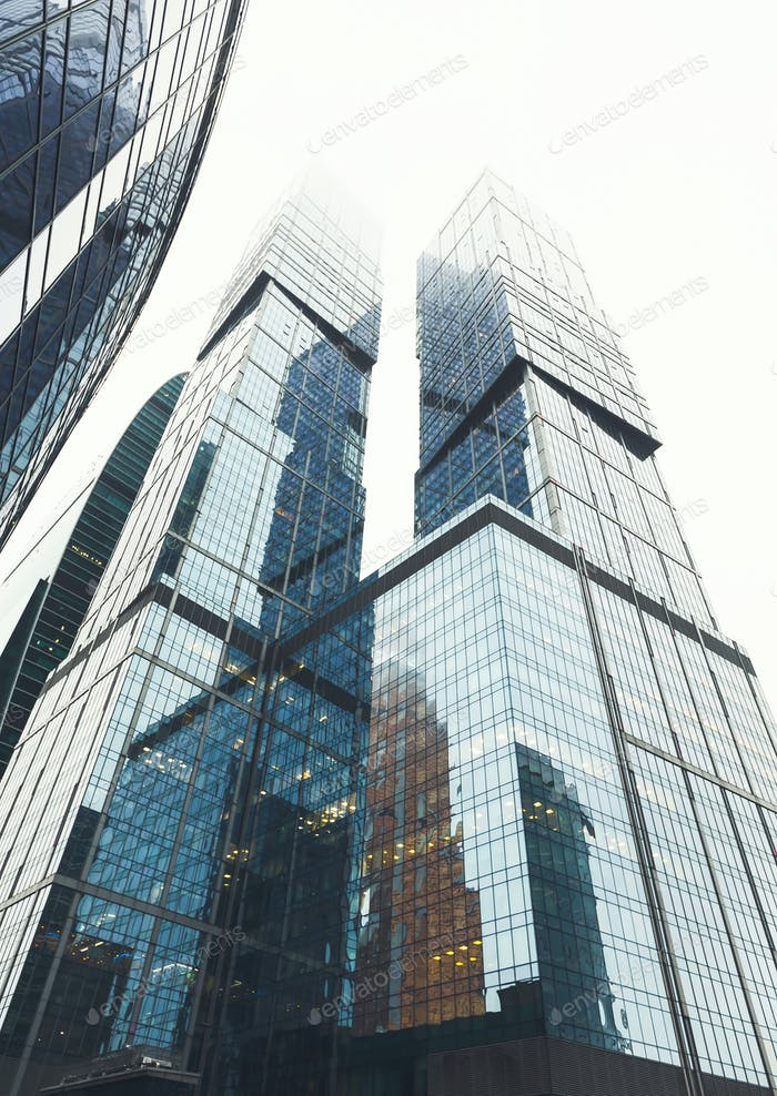 Glass facades of modern skyscrapers at business district