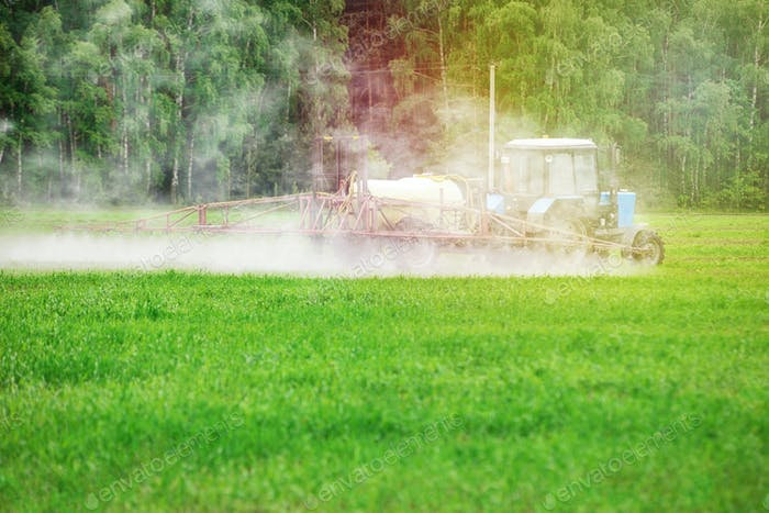 Tractror spraying pesticides, insecticide or herbicides