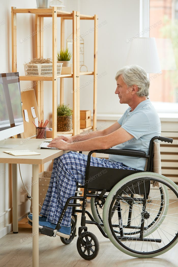 Disabled man working on computer