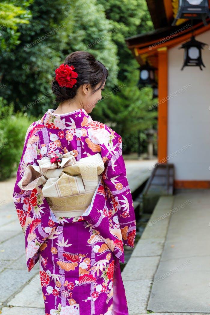The rear view of woman with kimono