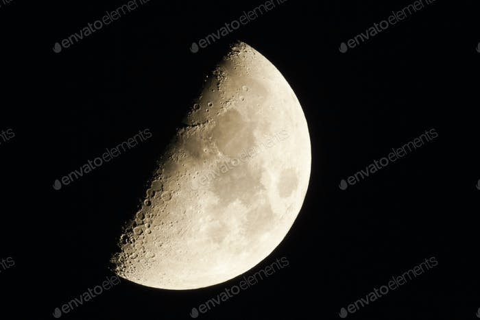 Half moon in a clear sky at night.
