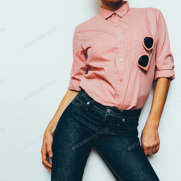 Girl in a pink shirt and classic jeans Stylish Clothing
