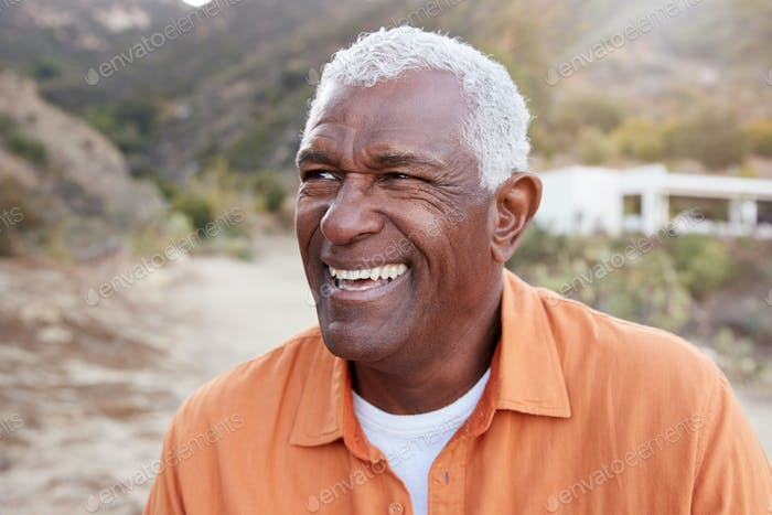 Portrait Of Smiling African American Senior Man Outdoors In Countryside
