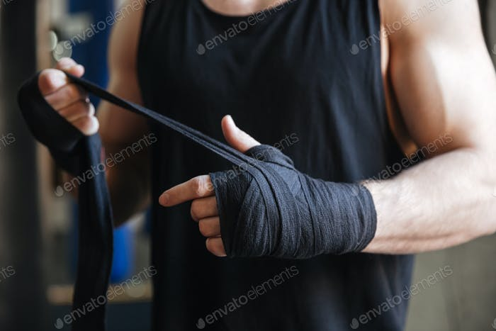Close up of hands of boxer in gloves