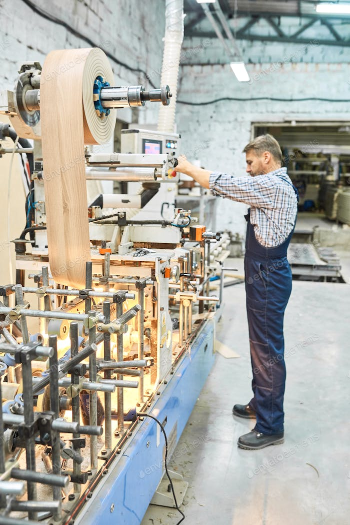 Mature Man Working at Modern Factory