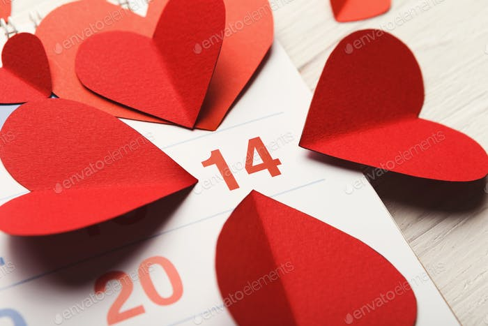 Calendar page with the red hearts on february 14