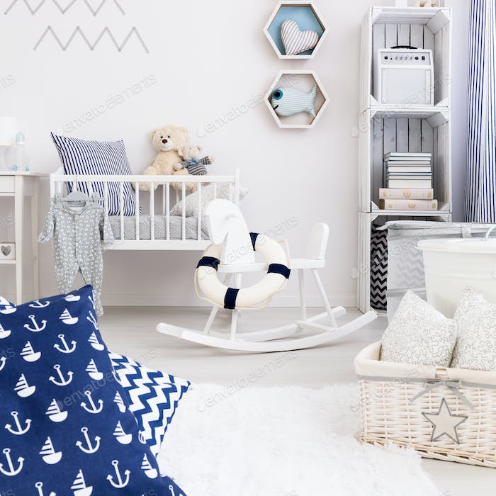 Light nursery with white furniture