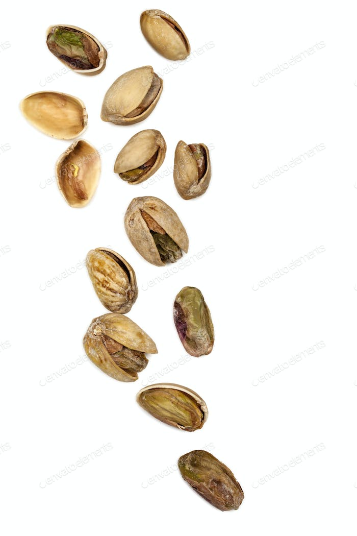 Scattered Pistachios Isolated on White