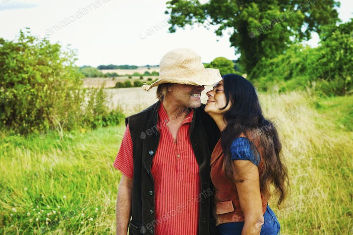 A man and woman kissing and hugging.