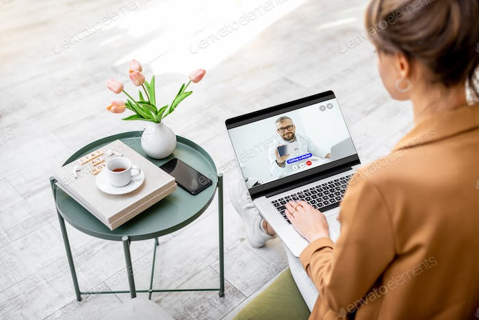 Woman having online consultation with a doctor