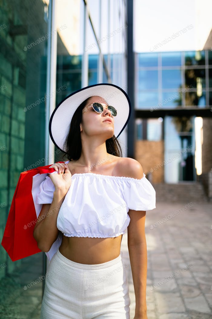 Beautiful young woman shopping and traveling on summer