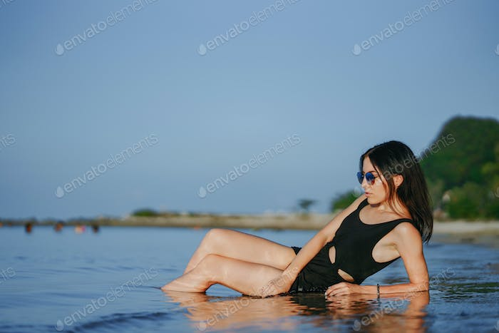 Girl laying on the beach