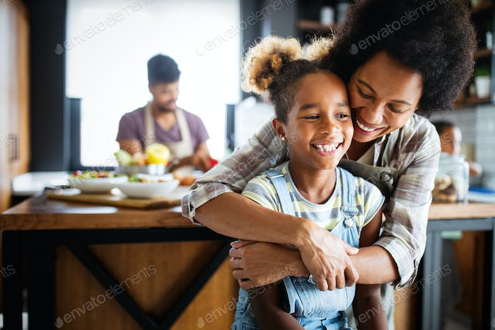 Mother and child having fun preparing healthy food in kitchen