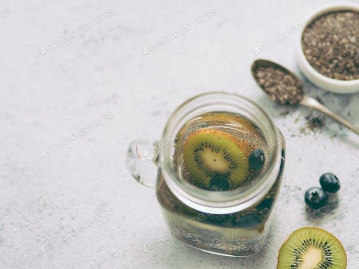 Kiwi and blueberry chia water in mason jar