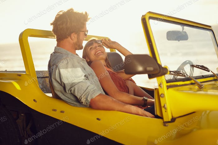 Romantic young couple in a car