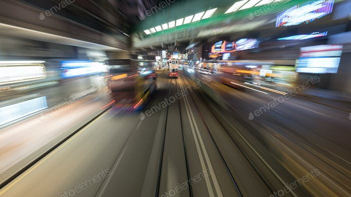 Traveling by tram in Hong Kong at night