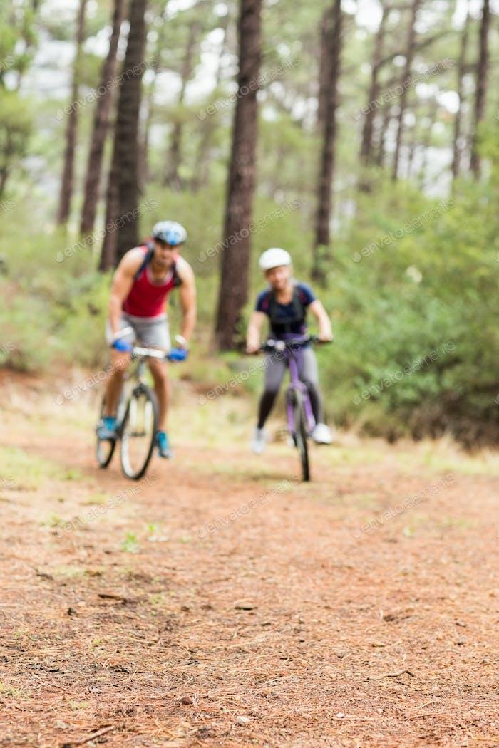 Pretty biker couple biking in the nature