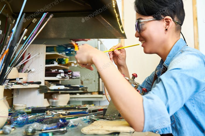 Asian Artist Shaping Glass