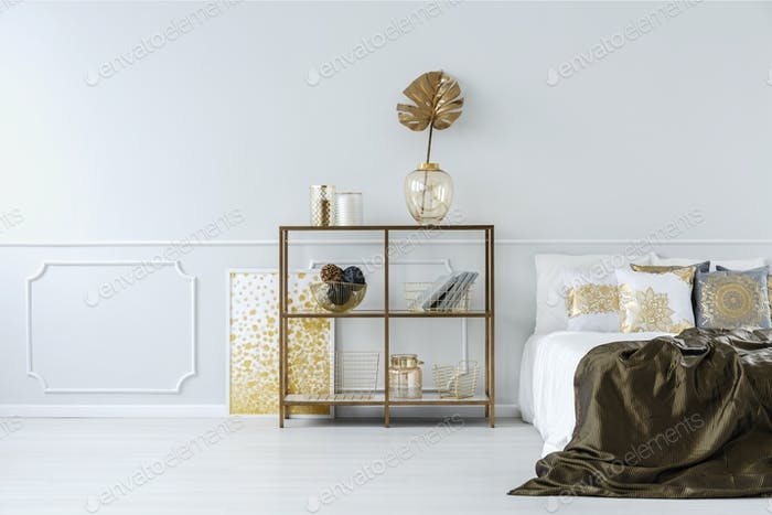 Sophisticated gold bedroom interior