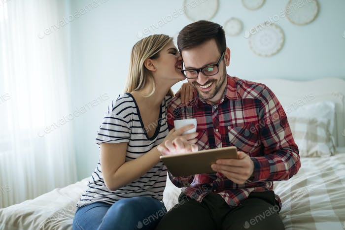 Couple in love using tablet to surf and shop
