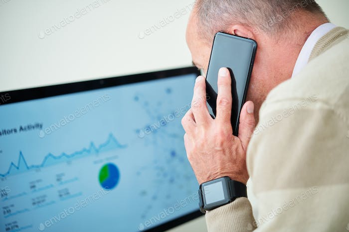 Financial manager talking on phone