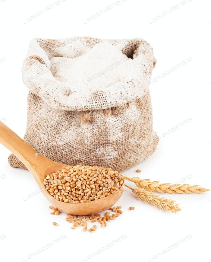 Flour in burlap bag with wheat ears