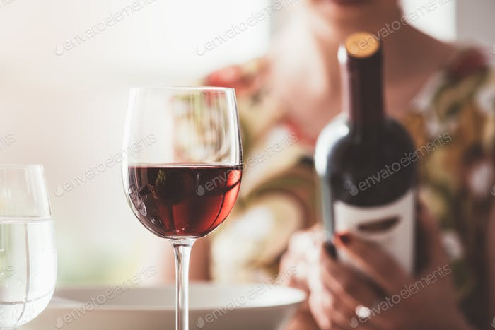 Woman reading a wine label