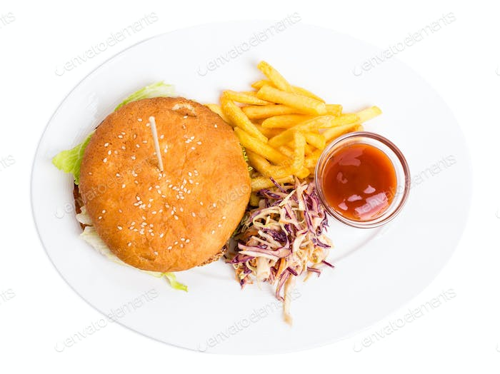 Chicken burger with french fries.