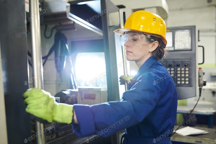 Woman Working at Plant
