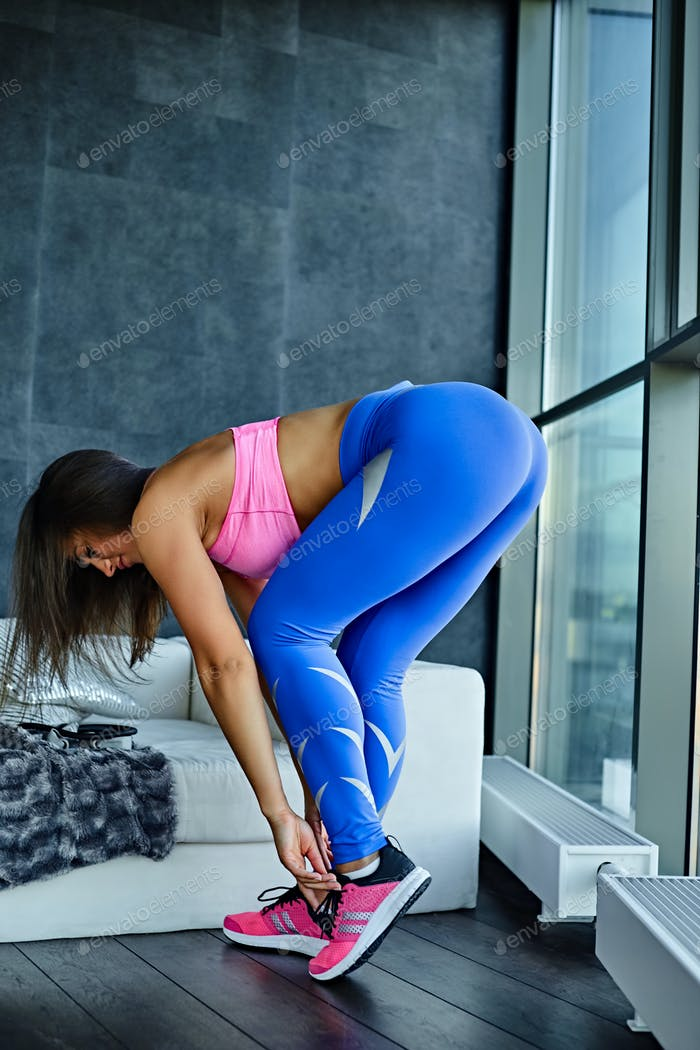 Flexible female in a living room.