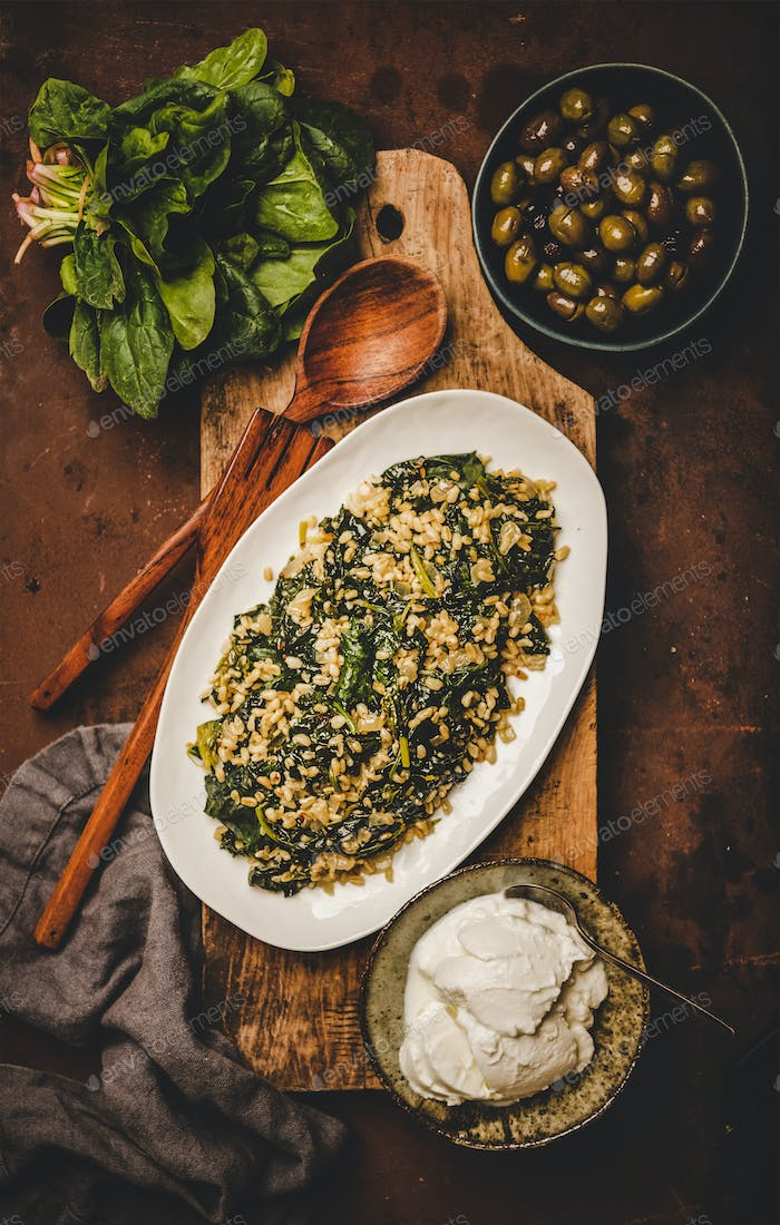 Flat-lay of Turkish traditional dish Bulgur and spinach
