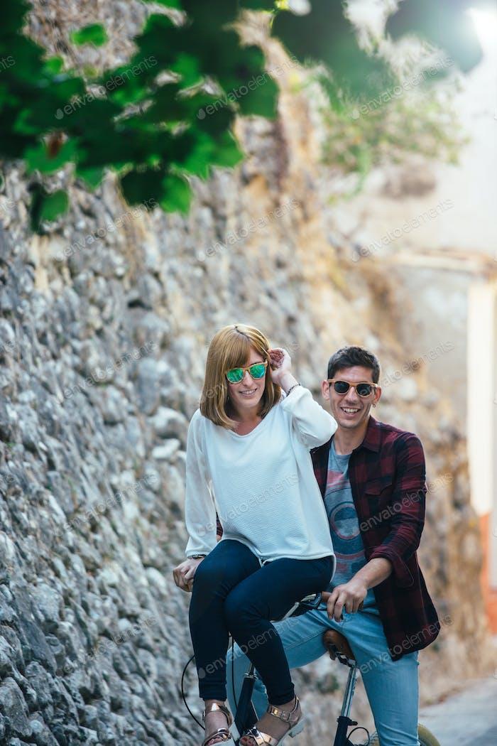 Happy couple on bike
