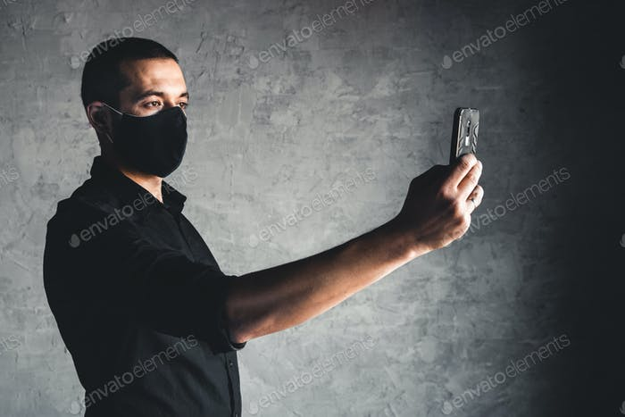 Caucasian man in mask. Protection versus viruses and infection. He is calling on the phone