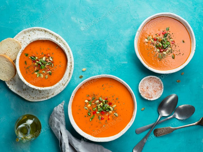 Gaspacho soup on blue, top view