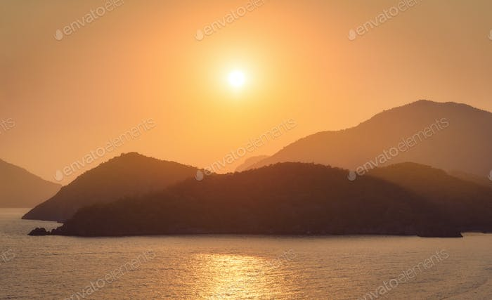 Beautiful seascape with silhouettes of mountain ridges