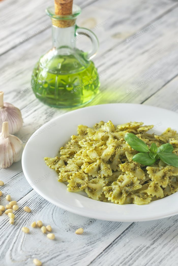 Portion of farfalle with pesto with ingredients