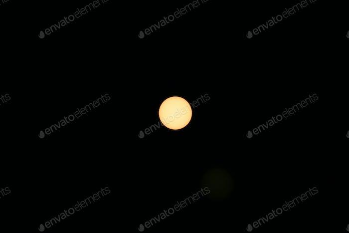Sun through a solar filter