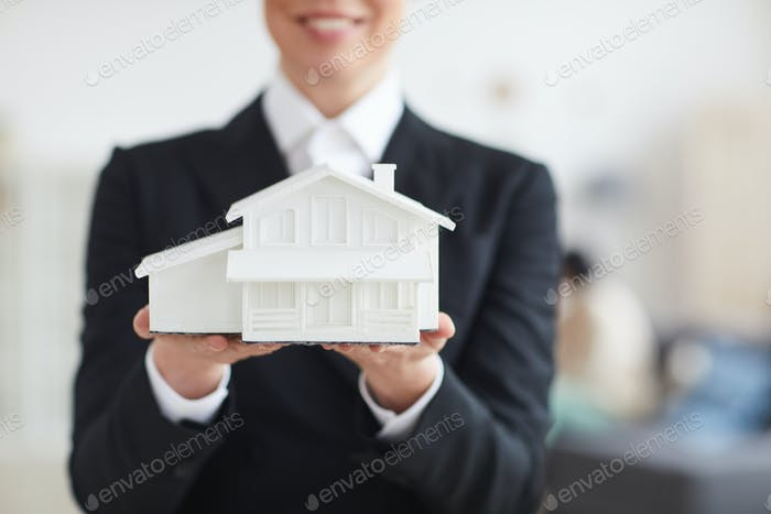 Woman with model of the house