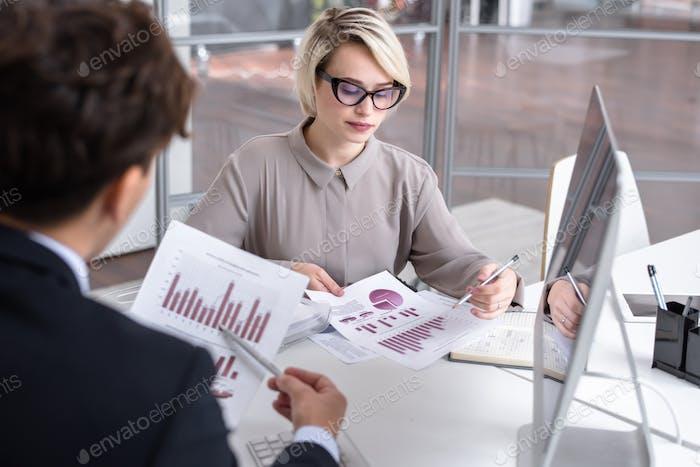 Marketing Director Analyzing Data
