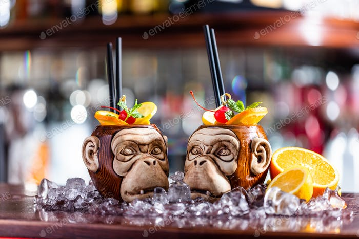 Coctail in monkey mugs on bar counter