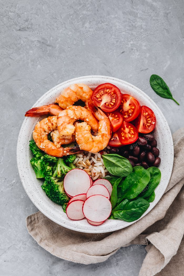 Shrimp Burrito Bowl with brown rice, spinach, radish, black beans, tomato and broccoli.