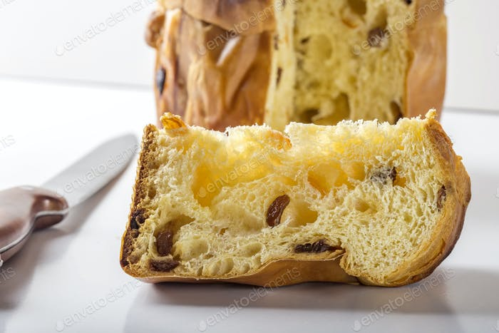 Slice of panettone with knife