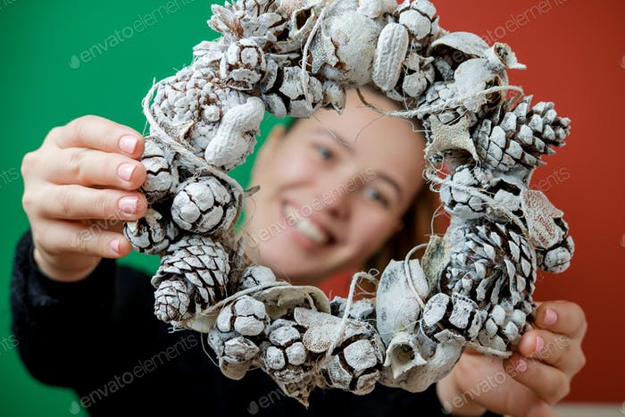 New Year's wreath in women's hands