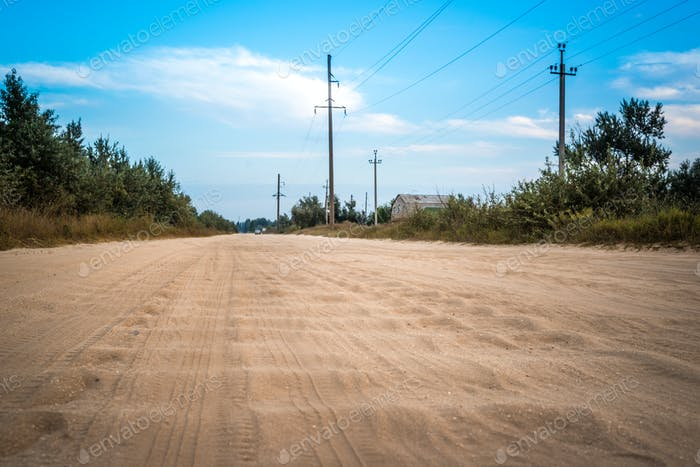 Dirt road with sandy waves