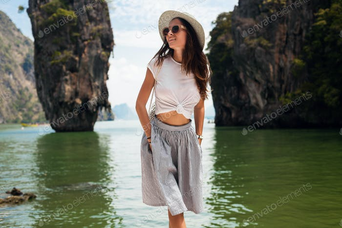 young beautiful woman traveling in thailand