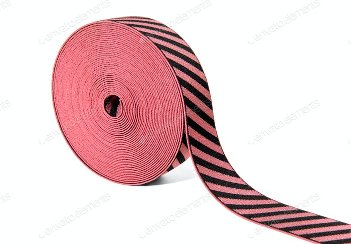 Roll of decorative elastic ribbon in red and black